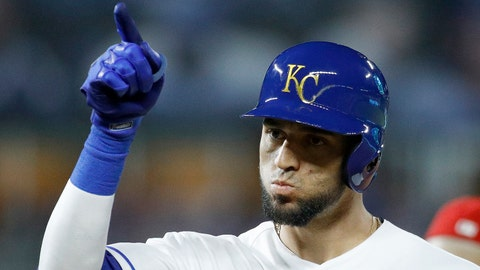 Kansas City Royals' Paulo Orlando celebrates after hitting an RBI-single during the fourth inning of a baseball game against the Los Angeles Angels, Friday, April 13, 2018, in Kansas City, Mo. (AP Photo/Charlie Riedel)