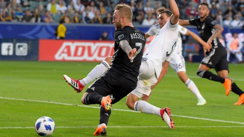 Apr 8, 2018; Carson, CA, USA; Sporting Kansas City forward Johnny Russell (7) maneuvers by Los Angeles Galaxy defender Daniel Steres (5) in the first half of an MLS soccer match at StubHub Center. Mandatory Credit: Kirby Lee-USA TODAY Sports