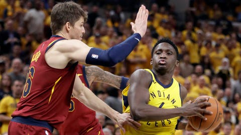 Indiana Pacers' Victor Oladipo, right, heads to the basket as Cleveland Cavaliers' Kyle Korver defends during the second half of Game 6 of a first-round NBA basketball playoff series, Friday, April 27, 2018, in Indianapolis. (AP Photo/Darron Cummings)