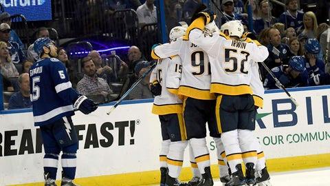 The Nashville Predators celebrate Filip Forsberg's (9) third period against the Tampa Bay Lightning during an NHL hockey game Sunday, April 1, 2018, in Tampa, Fla. (AP Photo/Jason Behnken)