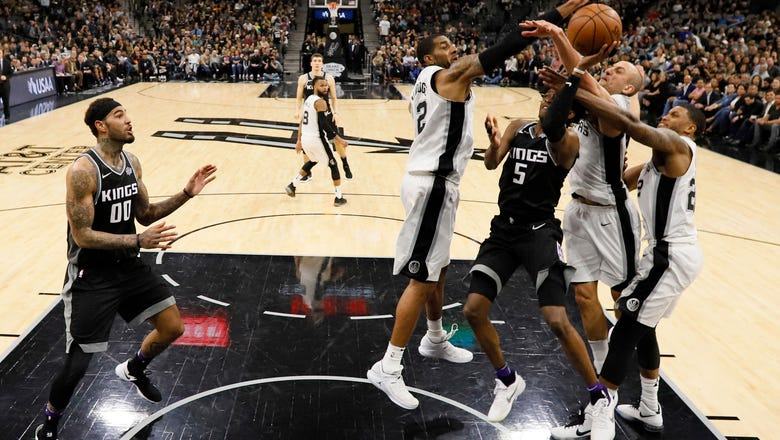 Gay, Ginobili lead Spurs over Kings to clinch playoff berth