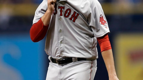 Boston Red Sox relief pitcher Carson Smith eaves the field during the eighth inning of a baseball game against the Tampa Bay Rays, Thursday, March 29, 2018, in St. Petersburg, Fla. (AP Photo/Chris O'Meara)
