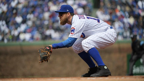 Chicago Cubs first baseman Ben Zobrist plays in place of the injured Anthony Rizzo during the team's baseball game against the Pittsburgh Pirates at Wrigley Field in Chicago on Tuesday, April 10, 2018. (John Starks/Daily Herald via AP)