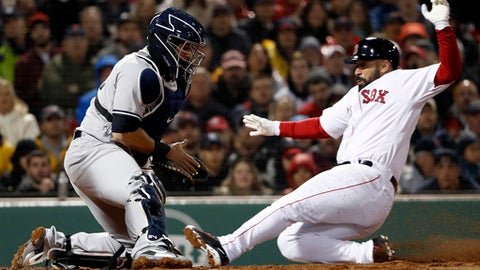 Boston Red Sox's Sandy Leon scores as New York Yankees catcher Gary Sanchez doesn't handle the throw during the second inning of a baseball game at Fenway Park in Boston on Thursday, April 12, 2018. (AP Photo/Winslow Townson)