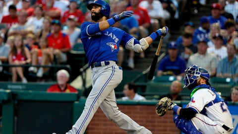 FILE - In this June 20, 2017, file photo, Toronto Blue Jays' Jose Bautista follows through on a fly out to center in the fourth inning of a baseball game as Texas Rangers catcher Jonathan Lucroy, right, watches, in Arlington, Texas. Six-time All-Star Jose Bautista and the Atlanta Braves have agreed to a minor league contract. Under the deal announced Wednesday, April 18, 2018, Bautista would receive a $1 million, one-year deal if added to the 40-man major league roster. (AP Photo/Tony Gutierrez, File)