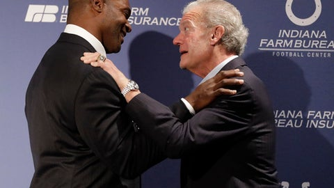 Former Indianapolis Colts player Dwight Freeney, left, talks with Indianapolis Colts owner Jim Irsay following news conference at the NFL team's practice facility, Monday, April 23, 2018, in Indianapolis. Freeney retired as an Indianapolis Colt after 16 years in the league. (AP Photo/Darron Cummings)