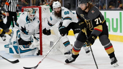Vegas Golden Knights center William Karlsson (71) skates around San Jose Sharks defenseman Brent Burns (88) during the second period of Game 1 of an NHL hockey second-round playoff series, Thursday, April 26, 2018, in Las Vegas. (AP Photo/John Locher)