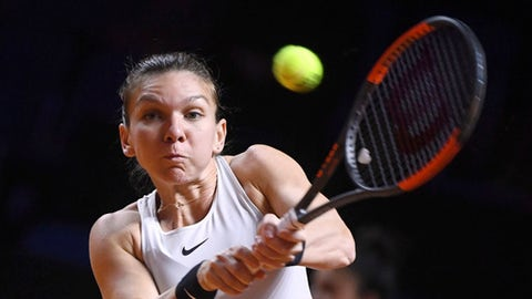 Romania's Simona Halep returns a shot to Coco Vandeweghe from the U.S. during their match at the WTA tennis tournament in Stuttgart, Germany, Friday, April 27, 2018. (Marijan Murat/dpa via AP)