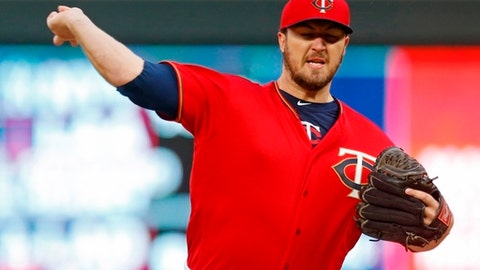 Minnesota Twins pitcher Phil Hughes throws against the Cincinnati Reds in the first inning of a baseball game Friday, April 27, 2018, in Minneapolis. (AP Photo/Jim Mone)