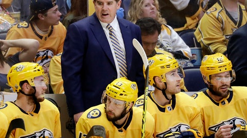 Nashville Predators head coach Peter Laviolette, top center, talks to his players during the first period in Game 1 of an NHL hockey second-round playoff series against the Winnipeg Jets, Friday, April 27, 2018, in Nashville, Tenn. (AP Photo/Mark Humphrey)