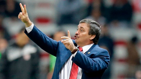 In this photo taken on Tuesday, March 27, 2018 Costa Rica head coach Oscar Ramirez reacts during a friendly soccer match between Tunisia and Costa Rica at the Allianz Riviera stadium in Nice, southern France. (AP Photo/Claude Paris)