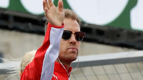 Ferrari driver Sebastian Vettel, of Germany, waves during a drivers parade prior to the start of the Azerbaijan Formula One Grand Prix, at the city circuit, in Baku, Azerbaijan, Sunday, April 29, 2018. (AP Photo/Luca Bruno)