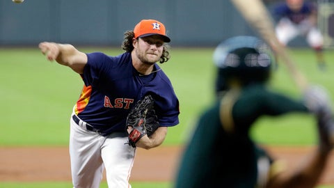 Houston Astros' starting pitcher Gerrit Cole throws against Oakland Athletics' shortstop Marcus Semien (10) during the first inning of a baseball game Sunday, April 29, 2018, in Houston. (AP Photo/Michael Wyke)