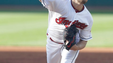 Cleveland Indians starting pitcher Trevor Bauer delivers in the first inning of a baseball game against the Texas Rangers, Monday, April 30, 2018, in Cleveland. (AP Photo/Tony Dejak)