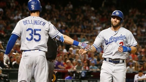 Los Angeles Dodgers' Chris Taylor (3) celebrates his run scored against the Arizona Diamondbacks with Cody Bellinger (35) during the sixth inning of a baseball game Monday, April 30, 2018, in Phoenix. (AP Photo/Ross D. Franklin)