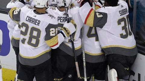 Vegas Golden Knights players celebrate after center William Karlsson, from Sweden, scored the winning goal against the San Jose Sharks during overtime of Game 3 of an NHL hockey second-round playoff series in San Jose, Calif., Monday, April 30, 2018. The Golden Knights won 4-3. (AP Photo/Jeff Chiu)