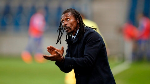 In this photo taken on Tuesday, March 27, 2018, Senegal's head coach Aliou Cisse reacts during a friendly soccer match between Senegal and Bosnia and Herzegovina at the Oceane stadium in Le Havre, northern France. (AP Photo/Francois Mori)
