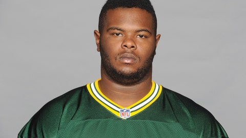 FILE - This is a 2014 file photo showing former Green Bay Packers NFL football player Carlos Gray. Authorities say a former Green Bay Packers player has been found shot to death in his home in Alabama. The Jefferson County Coroner's Office says former Packers defensive lineman Carlos Gray was found shortly before 10 p.m. Monday, April 30, 2018, near Birmingham, Alabama. The 25-year-old is a native of Pinson, Alabama. (AP Photo/File)
