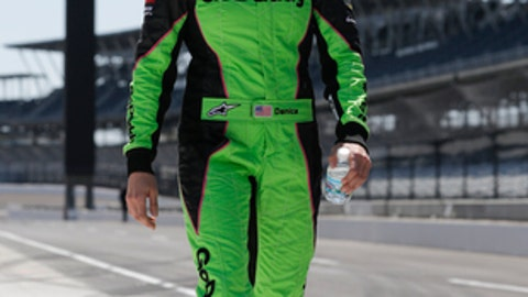 IndyCar driver Danica Patrick walks through the pit area as she prepares to drive her refresher test at the Indianapolis Motor Speedway in Indianapolis, Tuesday, May 1, 2018. (AP Photo/Michael Conroy)
