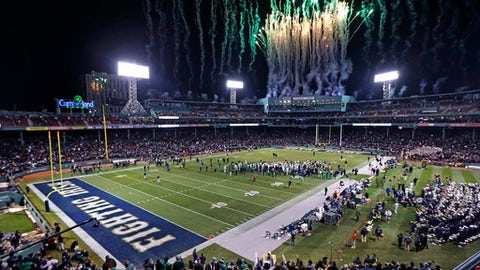 File - In this Nov. 21, 2015 file photo, fireworks light up the sky at the conclusion of the Shamrock Series NCAA college football game between Notre Dame defeated Boston College at Fenway Park, home of the Boston Red Sox baseball club in Boston. Yale will play Harvard in November at Fenway Park, for the 135th edition of the rivalry. (AP Photo/Charles Krupa File)