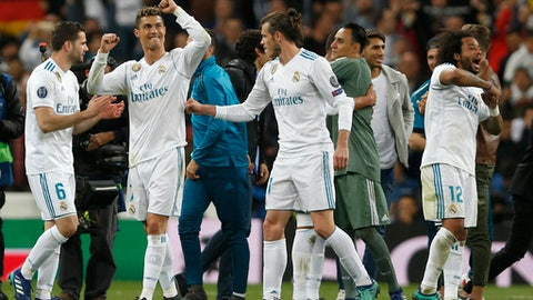 Real Madrid's Cristiano Ronaldo, left, celebrates with team mates after the Champions League semifinal second leg soccer match between Real Madrid and FC Bayern Munich at the Santiago Bernabeu stadium in Madrid, Spain, Tuesday, May 1, 2018. (AP Photo/Francisco Seco)