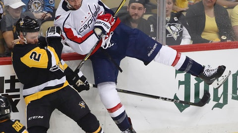 Pittsburgh Penguins' Chad Ruhwedel (2) collides with Washington Capitals' Tom Wilson (43) during the first period in Game 3 of an NHL hockey second-round playoff series in Pittsburgh, Tuesday, May 1, 2018. (AP Photo/Gene J. Puskar)