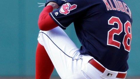 FILE - In this April 9, 2018, file photo, Cleveland Indians starting pitcher Corey Kluber winds up during the first inning of the team's baseball game against the Detroit Tigers in Cleveland. Kluber is 4-1 going into Wednesday's game against Texas and has won four consecutive starts. (AP Photo/Tony Dejak, File)