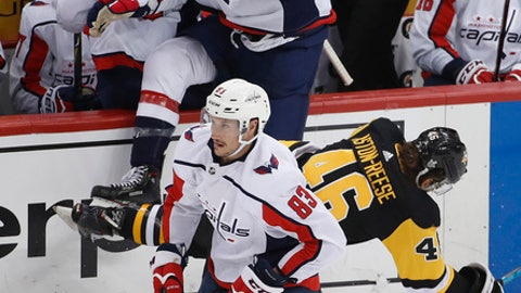 Washington Capitals' Tom Wilson (43) collides with Pittsburgh Penguins' Zach Aston-Reese (46) during the second period in Game 3 of an NHL second-round hockey playoff series in Pittsburgh, Tuesday, May 1, 2018. (AP Photo/Gene J. Puskar)