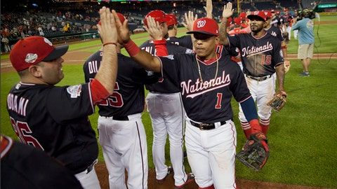 Washington Nationals' Wilmer Difo (1) and Howie Kendrick (12) celebrate with teammates at te end of a baseball game against the Pittsburgh Pirates at Nationals Park, Tuesday, May 1, 2018, in Washington. The Nationals won 12-4. (AP Photo/Pablo Martinez Monsivais)