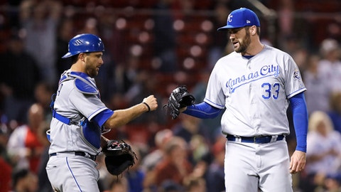 Kansas City Royals relief pitcher Brian Flynn (33) is congratulated by catcher Drew Butera after earning a save in the 7-6 win over the Boston Red Sox during a baseball game at Fenway Park in Boston, Tuesday, May 1, 2018. (AP Photo/Charles Krupa)