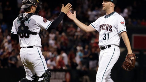 Arizona Diamondbacks catcher John Ryan Murphy greets relief pitcher Brad Boxberger (31) after a baseball game against the Los Angeles Dodgers on Tuesday, May 1, 2018, in Phoenix. The Diamondbacks won 4-3. (AP Photo/Matt York)