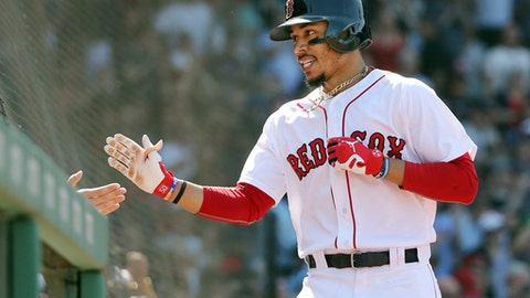 Boston Red Sox's Mookie Betts celebrates at the dugout after hitting his third home run of the game in the seventh inning of a baseball game against the Kansas City Royals at Fenway Park, Wednesday, May 2, 2018, in Boston. (AP Photo/Elise Amendola)