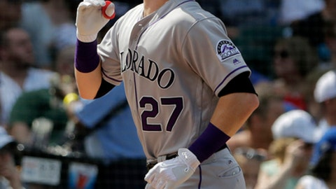 Colorado Rockies' Trevor Story celebrates after hitting a solo home run during the fifth inning of a baseball game against the Chicago Cubs, Wednesday, May 2, 2018, in Chicago. (AP Photo/Nam Y. Huh)