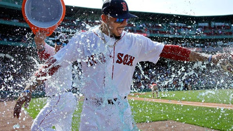 Boston Red Sox's Mookie Betts is drenched in a sports drink after their 5-4 victory over the Kansas City Royals in a baseball game at Fenway Park, Wednesday, May 2, 2018, in Boston. Betts hit three home runs in the game. (AP Photo/Elise Amendola)