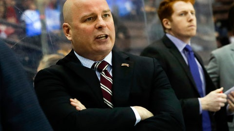 FILE - In this March 25, 2017, file photo, Denver head coach Jim Montgomery works the bench during the first period in the regional semifinals of the NCAA college hockey tournament against Michigan Tech in Cincinnati.  A person with knowledge of the situation tells The Associated Press that the Dallas Stars will hire Montgomery to be their next head coach. Montgomery takes over Ken Hitchcock, who retired last month and will become a consultant for the Stars. The person spoke on condition of anonymity Wednesday, May 2, 2018,  because the hiring had not been announced. (AP Photo/John Minchillo, File)