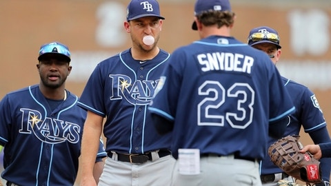 Tampa Bay Rays relief pitcher Matt Andriese stands on the mound as pitching coach Kyle Snyder (23) comes out for a visit during the 11th inning of a baseball game against the Detroit Tigers, Wednesday, May 2, 2018, in Detroit. (AP Photo/Carlos Osorio)