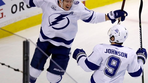 Tampa Bay Lightning left wing Ondrej Palat, left, celebrates with Tyler Johnson (9) after his goal off Boston Bruins goaltender Tuukka Rask during the first period of Game 3 of an NHL second-round hockey playoff series in Boston, Wednesday, May 2, 2018. (AP Photo/Charles Krupa)