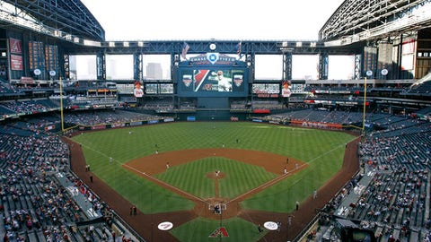 FILE - In this June 18, 2014, file photo, the Arizona Diamondbacks and the Milwaukee Brewers play a baseball game at Chase Field in Phoenix. The Diamondbacks have reached an agreement with Maricopa County that, among other things, would give the franchise the immediate right to explore rebuilding Chase Field or moving to another site. The memorandum of understanding also gives the Diamondbacks complete control of Chase, the downtown ballpark completed when the franchise was born in 1998. (AP Photo/Ralph Freso, File)