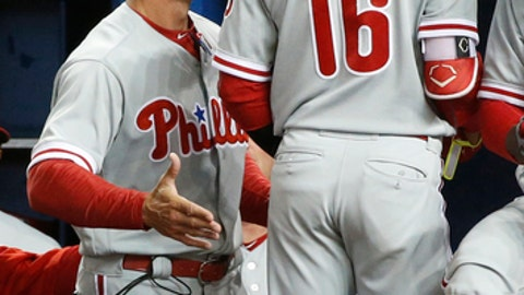Philadelphia Phillies manager Gabe Kapler, left, congratulates Cesar Hernandez (16) after Hernandez hit a home run during the first inning of the teams baseball game against the Miami Marlins, Wednesday, May 2, 2018, in Miami. (AP Photo/Wilfredo Lee)