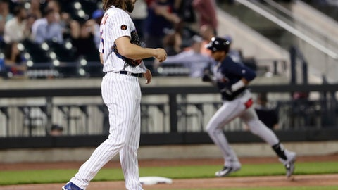 New York Mets relief pitcher Robert Gsellman waits as Atlanta Braves' Johan Camargo runs the bases after hitting a two-run home run during the eighth inning of a baseball game Wednesday, May 2, 2018, in New York. (AP Photo/Frank Franklin II)