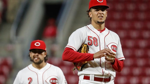 Cincinnati Reds starting pitcher Luis Castillo (58) waits to be removed during the seventh inning of the team's baseball game against the Milwaukee Brewers, Wednesday, May 2, 2018, in Cincinnati. (AP Photo/John Minchillo)