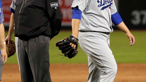 Los Angeles Dodgers starting pitcher Hyun-Jin Ryu leaves the baseball game against the Arizona Diamondbacks with an injury during the first inning Wednesday, May 2, 2018, in Phoenix. (AP Photo/Matt York)