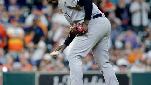New York Yankees' starting pitcher Luis Severino (40) drops the rosin bag at the mound during the ninth inning of the team's baseball game against the Houston Astros on Wednesday, May 2, 2018, in Houston. (AP Photo/Michael Wyke)