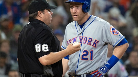 FILE - In this April 27, 2018, file photo, New York Mets' Todd Frazier, right, talks with umpire Doug Eddings during the team's baseball game against the San Diego Padres in San Diego. Frazier is asking for a meeting with Baseball Commissioner Rob Manfred over his growing frustration with the way umpires are calling balls and strikes. Frazier argued with home plate umpire Lance Barrett while New York was three-hit in a 7-0 loss to Atlanta on Wednesday night, then criticized umpiring around the league after the game. Id like to sit down with Manfred or anybody at MLB and talk to them about it, because its rubbing everybody the wrong way, Frazier said. You have to be better than that. (AP Photo/Kyusung Gong, File)
