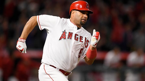 Los Angeles Angels' Albert Pujols rounds first and heads for second for a double during the fifth inning of a baseball game against the Baltimore Orioles Wednesday, May 2, 2018, in Anaheim, Calif. With the double Pujols broke a tie with Hank Aaron for career doubles, reaching 625, and brought his all-time career hits to 2,998. (AP Photo/Mark J. Terrill)