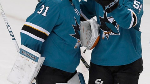 San Jose Sharks goalie Martin Jones (31) and center Chris Tierney celebrate after the Sharks defeated the Vegas Golden Knights 4-0 in Game 4 of an NHL hockey second-round playoff series in San Jose, Calif., Wednesday, May 2, 2018. (AP Photo/Jeff Chiu)