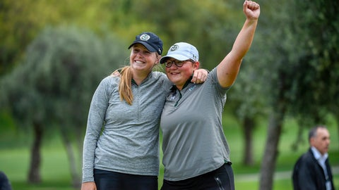 In this photo provided by the USGA Katrina Prendergast, left, and Ellen Secor celebrate after winning the 2018 U.S. Women's Amateur Four-Ball at El Caballero Country Club in Tarzana, Calif. on Wednesday, May 2, 2018.  (J.D. Cuban/USGA via AP)