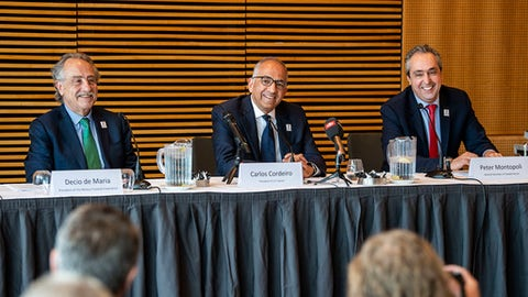 From left, Decio de Maria, President of the Football Association of Mexico , Carlos Cordeiro, President of the United States Football Association and Peter Montopoli, Secretary-General of the Football Association of Canada, talk during a press conference, after a meeting with Various Soccer Unions to present their bid to host the Soccer World Cup 2026, in Copenhagen, Thursday May 3, 2018. (Anders Kjaerbye/Ritzau Scanpix via AP)