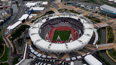 FILE - This Aug. 3, 2012, aerial file photo shows the Olympic Stadium at Olympic Park, in London. A person familiar with the planning tells The Associated Press that Major League Baseball intends to announce next week plans have been finalized to have the New York Yankees and Boston Red Sox play a two-game series at Londons Olympic Stadium on June 29-30 next year. The person spoke on condition of anonymity Thursday, May 3, 2018, because no public comments were authorized. These will be the first regular-season MLB games in Europe. The Red Sox will be the home team for the both games. (AP Photo/Jeff J Mitchell, File)