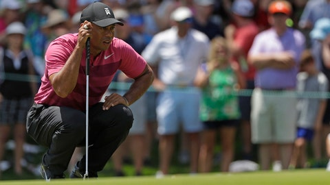 Tiger Woods lines up a putt on the second hole during the first round of the Wells Fargo Championship golf tournament at Quail Hollow Club in Charlotte, N.C., Thursday, May 3, 2018. (AP Photo/Chuck Burton)